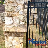 Limestone Fence After - Patriot SoftWash