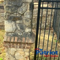 Limestone Fence Before - Patriot SoftWash